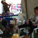 Johan strapping walker's feet at the Weekend Walk to End Women's Cancers